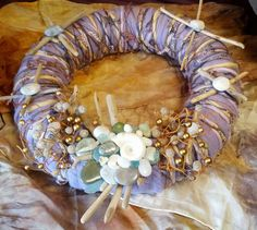 Wool and angora wreath, handmade and embellished with handpainted wool, driftwood, beach stones and sea glass. on Etsy, $75.00