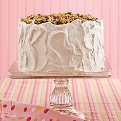 Lane Cake - Southern Living (Pecans, raisings, flaked coconut, and a little bourbon, top this classic Southern layer cake)