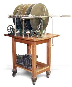 "Bonetti Influence Machine, 1884.  This impressive apparatus stands over five feet tall and contains ten 32"" disks.  The Bonetti device and others like it were used for medical therapy and to power early x-ray tubes."