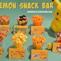"Whatever you choose to serve, a ""snack bar"" allows guests to serve themselves, which is convenient for everyone. <br/>Whatever you (or they) choose, these <a href=""http://sharingpartyideas.com/pokemon-party-food-cards/"" target=""_blank"">Pokemon food cards</a> will help maintain your party's theme, and make what you serve even more fun!"