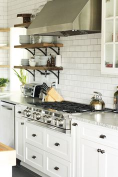 white subway tile stainless steel range