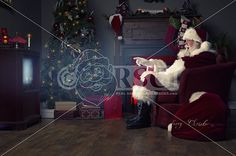 A real authentic Christmas photo of Santa Claus watching tv and getting excited and This images can be licensed to use at realsantaimages.com | Do Not Use Without A License