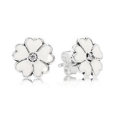Light and delicate in expression, these simple primrose silver stud earrings with cubic zirconia and white enamel are a superb choice for everyday wear and will convey a classic and understated look. #PANDORA #PANDORAearrings #Spring2015
