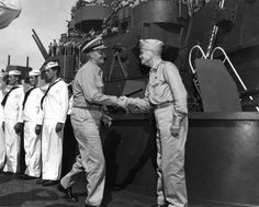 Fleet Admiral Nimitz and Admiral Halsey shaking hands aboard battleship USS South Dakota, Tokyo Bay, Japan, 29 Aug 1945.