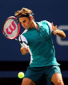 Roger Federer of Switzerland returns a shot to Philipp Kohlschreiber of Germany during their Men's Singles Third Round match on Day Six of the 2015 US Open on Sept. 5, 2015 .
