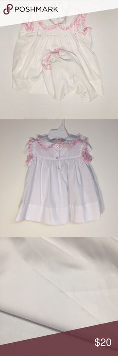 Vintage Polly Flinders 18M Smocked Dress, Bloomers Vintage 80s Girls Polly Flinders 18 Months Pink White Smocked Dress & Bloomers White a-line dress with smocking across the chest and embroidered roses Sleeveless with elastic around the pink embroidered arm holes Ruffled Peter Pan collar with pink embroidery 2 buttons up the back Bloomers have pink embroidery around the leg holes Excellent condition with some very hard to notice discoloration on the skirt hem 65% polyester & 35% cotton and…