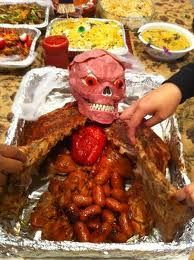 Grill your chicken, mini sausages, and ribs. Throw in a red bell pepper and a skull covered with ham or salami and wha-la you have a creepy main dish!