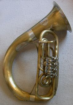 The Helicon is a brass musical instrument in the tuba family   An old Helikon instrument manufactured in Graz,Styria,Austria.   Photo by Matthias Bramboeck   Musical Instruments: Brass