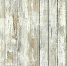 Turn paneling into faux weathered wood by using white, grey, & tan chalk paint.