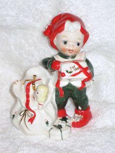 Vintage Christmas Lefton Pixie Elf Santa helper figurine porcelain Doll Presents Toys Foil sticker Japan Spaghetti trim. $40.00, via Etsy.