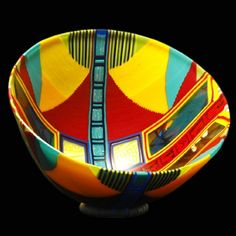 """Doug Randall,""""Chino Basket"""" 9""""h, 14""""w, 14""""d. $3,800. His creations are spiritual in nature. A childhood fascination with stained glass cathedral windows is evident in monochromatic expanses punctured by """"windows"""" into highly textured, multi-colored mosaic inlays that represent the many cultures, religions, races, of individuals experienced on his many journeys.  """"Windows"""" provide a framework, point of view from which harmonious patterns of life can be considered & appreciated."""
