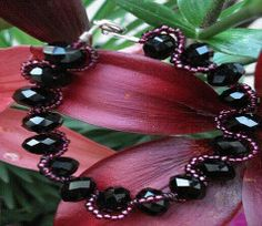Violet red Japanese seed beads zig zag black oval crystals. Available at theriveracollection.com