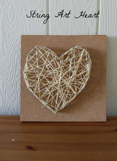 String heart art!  A great Valentine's Day craft for preschoolers and big kids too.  Hammer optional (but really fun)