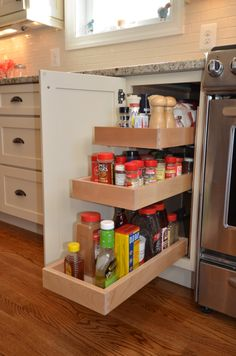 This is my favorite spice cabinet.  It will hold any size container.