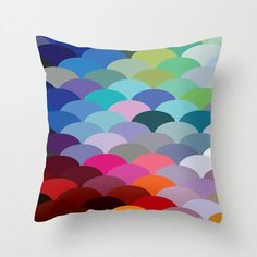 Celebrate color with this remarkable fish scale_patterned pillow cover. Whether you're decorating in a maritime theme or just love this pillow for its riot of hues, it'll be a bright spot in your home.