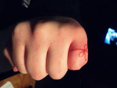 Red string of fate tattoo. The legend goes that you have an invisible red string of fate tied to your pinky that leads to your soul mate. No matter how far you go or how long you live, you will find each other.