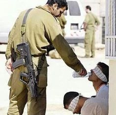 IDF soldier giving water to Hamas terrorist. Would this happened if it was in reverse? I would say that the Israeli IDF have the mercy of God in them.