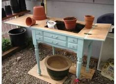 Turn an old sewing machine cabinet into a potting bench!