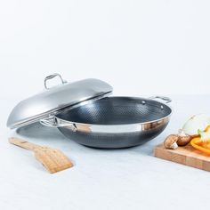 The 14 Inch Clad Wok with Lid allows for high volume cooking and perfect for stirfrys, sauces, pasta, soup and more! Shop our Hybrid Cookware here! Cool Kitchen Gadgets, Kitchen Items, Cool Kitchens, Kitchen Things, Kitchen Tools, Cooking Gadgets, Cooking Tools, Electric Cooktop, Kitchen Must Haves