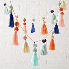 Shop Soft Festival Garland.  This colorful hanging garland is like a party for your décor.  It's adorned with playful tassels, pom poms and wooden beads for a truly festive look.
