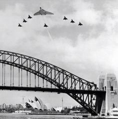 Vulcan with an escort of Australian Airforce jets over Sydney Harbour 1970s.