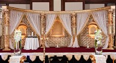 love the columns draping and wall details of this reception stage, also love the open feel and colors