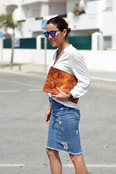 distressed denim skirt, white top, animal print clutch