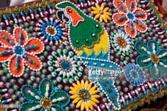 Foto de stock : Close-up high angle view of a Capac Colla traditional hat with parrot and flower motifs showing colourful ornate styling, detailing and embroidery, Cusco, Peru.