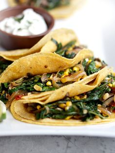 """Swiss Chard and Chipotle Tacos vegetarian recipe   Saveur """"Onions, mushrooms, sweet corn, and chiles in adobo add hearty, smoky flavor to these vegetarian tacos."""""""