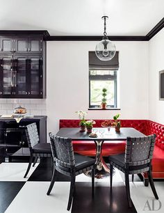 Fabulous breakfast area! Love the red #banquette seating. #ArchDigest #interior #homedecor #highfashionhome #dining #interiordesign #red #blackandwhite