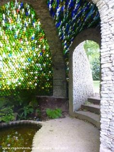 This beautiful dome shed roof has been created using 5000 glass bottles, and was designed by JRR Tolkien Wine Bottle Wall, Bottle House, Bottle Garden, Bottle Art, Shed Of The Year, Earthship Home, Bottle Trees, Glass Bottles, Wine Bottles