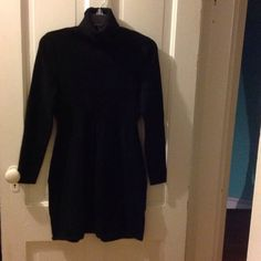 Turtle neck dress Turtle neck dress.  The material is 45%cotton, 28% acrylic and 27% nylon the color is onyx black the blackest you can find and I never wore this dress.  This is a non-smoking  home Daisy Fuentes Dresses Long Sleeve