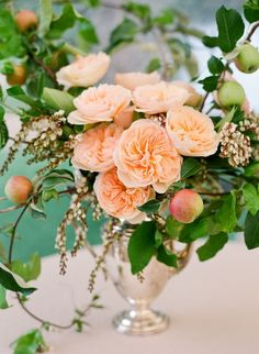 Peach and white garden roses, passion vine, andromeda flowers, acorns, apples, pears and dusty miller