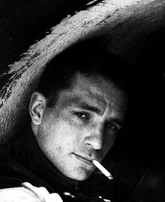 Jack Kerouac.  Too good looking for his own good. No doubt.  Dangerous.