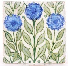 William de Morgan - A square tile decorated with three handpainted flowers in blue with foliage against a white ground #tile #ukauctioneers