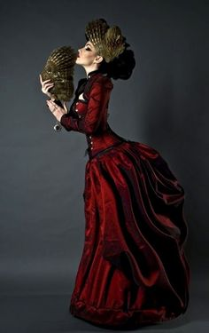 Crimson Red Neo-Victorian Bustle Dress - Perfect gothic (or steamgoth) evening gown (matching skirt, corset, bolero jacket) - For costume tutorials, clothing guide, fashion inspiration photo gallery, calendar of Steampunk events, & more, visit SteampunkFashionGuide.com