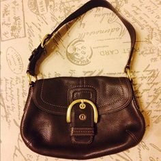 Make me an offer! Dark Brown Coach Purse 100% authentic Coach purse. Fold-over flap with large gold buckle detail, pockets inside and large body pocket on back. In perfect condition. Coach Bags