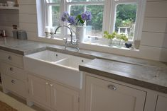 Double belfast sink with concrete tops and in-built drainer.