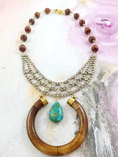 """Head Up Heart Open"" - 1960's rhinestone bib necklace with a wood horn pendant on wood chain handcrafted in Madagascar"