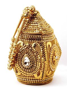 Glamorous #Potli #Purse made of gold plated brass metal decorated with crystals. Item code ; SJBP2006 http://www.bharatplaza.com/new-arrivals/accessories.html