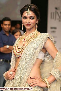 Golden girl Deepika in a saree.