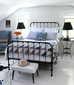*dormer attic bedroom* Serene Palettes:     A collection of vintage finds can come together seamlessly when working with a controlled palette. Here, black and white and an array of blues create a humble, calming ambience perfect for highlighting 20th century American pieces. The antique iron bed is strong and elegant, a contrast to the white paneled walls and woods floors.