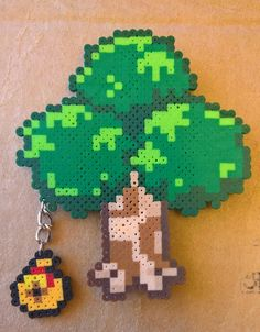 Animal Crossing tree with bells magnet. Melty Bead Patterns, Pearler Bead Patterns, Beading Patterns, Perler Patterns, Beaded Bracelet Patterns, Beaded Bracelets, Perler Bead Templates, Diy Perler Beads, Perler Bead Art