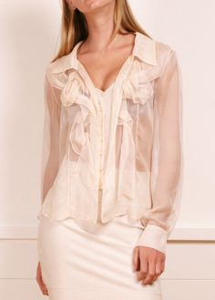 Celine sheer cream blouse- This flouncy, airy button-down blouse looks effortlessly chic. Elegant gathered detailing around the bust.