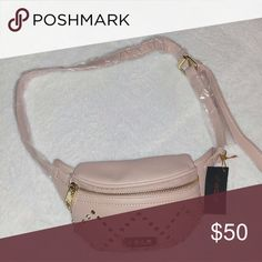 "Bebe Gemma Fanny Pack Size: 4.5""  W x 9"" L  Color: Blush   Feature: -Studded exterior  - Extendable stap - Zip Closure - Interior: 1 zip wall pocket bebe Bags"