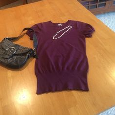 Gap Short Sleeve Knit Top Wine colored short sleeve Gap sweater. 66% cotton, 34% nylon. Excellent condition, hardly worn! GAP Sweaters Crew & Scoop Necks
