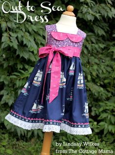 Out to Sea ~ Nautical Girls Dress. Pattern is the Charlotte Apron Dress by The Cottage Mama. #SarahJaneStudios