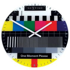 Check out this Glass Wall Clock! It has so many different things going on! With the absence of numerals, the clock relies on the ticks around the perimeter of the face to help guide you. The clock screams the and is a great way to add a functional co