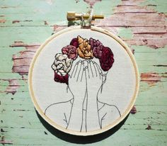 Thea is a little bit shy, but shes so cute! She has a hand stitched floral crown over printed outlines. She looks lovely with her other floral crown friends (see image 3 and 4 for examples). She comes ready to hang and would be a lovely gift for that quirky friend.  Details: - 1x 3inch Embroidery hoop - Background cotton fabric in Natural Seeded Cream - Outlines printed onto the fabric in Charcoal - Orange, Dusty Pinks, Magenta and Black cotton thread - Ready to hang with cream thread and…