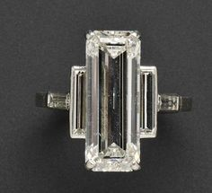 Cartier - emerald-cut flanked by baguettes